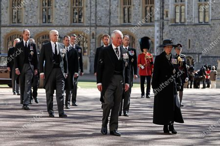 From front left, Britain's Prince Charles, Princess Anne, Prince Andrew. Prince Edward, Prince William, Peter Phillips, Prince Harry, Earl of Snowdon and Tim Laurence follow the coffin in a ceremonial procession for the funeral of Britain's Prince Philip inside Windsor Castle in Windsor, England . Prince Philip died April 9 at the age of 99 after 73 years of marriage to Britain's Queen Elizabeth II
