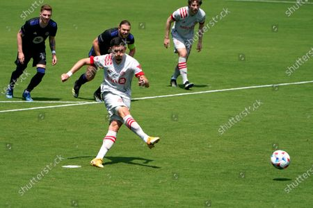 Toronto FC midfielder Marco Delgado scores on a penalty kick during the first half of an MLS soccer match against the Montreal Impact, in Fort Lauderdale, Fla