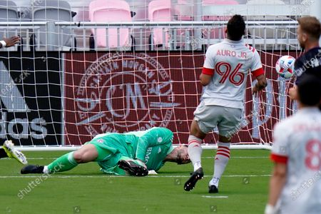 Stock Image of The ball gets past Toronto FC goalkeeper Alex Bono for a goal scored by CF Montreal forward Mason Toye during the first half of an MLS soccer match, in Fort Lauderdale, Fla