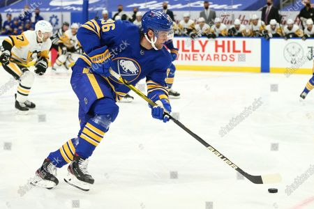 Buffalo Sabres forward Anders Bjork (96) controls the puck during the first period of an NHL hockey game against the Pittsburgh Penguins, in Buffalo, N.Y