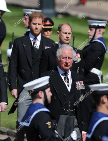 Prince Harry, Prince Edward and Prince Charles. The ceremonial procession at the funeral of Prince Phillip, Duke of Edinburgh at St. George's Chapel, Windsor Castle