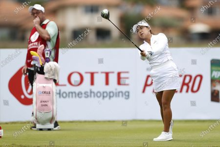 Jenny Shin, of South Korea, follows her drive on the 13th tee during the final round of the Lotte Championship golf tournament, in Kapolei, Hawaii