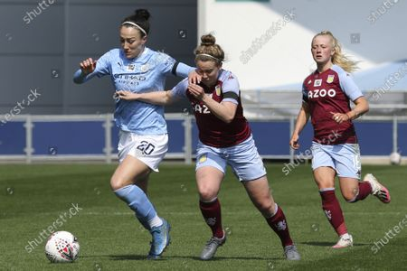 Lucy Bronze (20 Manchester City) (left) competing against Emily Syme (14 Aston Villa) (right)