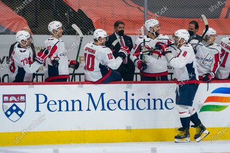 Stock Image of Washington Capitals' Alex Ovechkin celebrates his goal with teammates during the first period of an NHL hockey game against the Philadelphia Flyers, in Philadelphia. The Capitals won 6-3