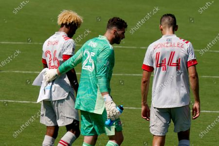 Stock Picture of Toronto FC goalkeeper Alex Bono (25), center, talks with defender Luke Singh (26) and defender Omar Gonzalez (44) during the second half of an MLS soccer match against CF Montreal, in Fort Lauderdale, Fla. CF Montreal won 4-2