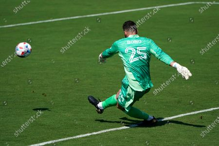 Toronto FC goalkeeper Alex Bono (25) makes a save during the second half of an MLS soccer match against CF Montreal, in Fort Lauderdale, Fla. CF Montreal won 4-2