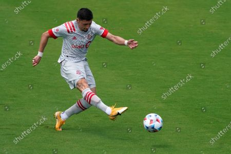 Toronto FC midfielder Marco Delgado attempts a shot on the goal during the first half of an MLS soccer match against CF Montreal, in Fort Lauderdale, Fla