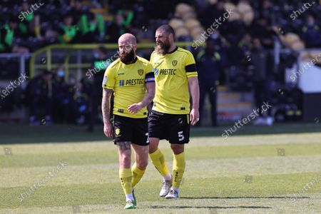 Michael Bostwick of Burton Albion and teammate John Brayford during the Sky Bet League 1 match between Burton Albion and Plymouth Argyle at the Pirelli Stadium, Burton upon Trent, England on 17th April 2021.