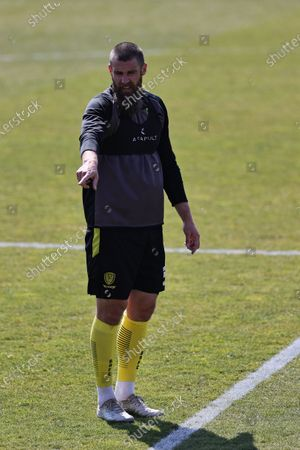 Michael Bostwick of Burton Albion warms up ahead of the Sky Bet League 1 match between Burton Albion and Plymouth Argyle at the Pirelli Stadium, Burton upon Trent, England on 17th April 2021.