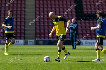 Jason Taylor of Barrow warms up prior to the Sky Bet League 2 match between Leyton Orient and Barrow at the Matchroom Stadium, London, England on 17th April 2021.