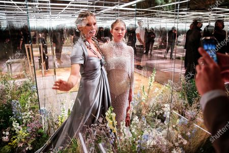 Stock Picture of Model Kate Moss, left, and her daughter Lila Grace Moss wear a creation for Fendi's Spring-Summer 2021 Haute Couture fashion collection presented in Paris. The pandemic has torn a multibillion-dollar bite out of the fabric of Europe's luxury industry, stopped runway shows and forced brands to show their designs digitally instead. Now, amid hopes of a return to near-normality by the year's end, the industry is asking what fashion will look like as it dusts itself and struggles to its well-heeled feet again
