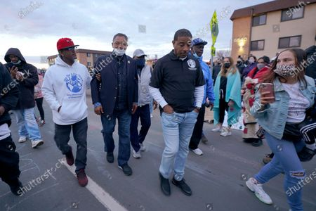The Rev. Jesse Jackson, center left, walks with supporters during a protest over the fatal shooting of Daunte Wright by a police officer during a traffic stop, outside the Brooklyn Center Police Department, in Brooklyn Center, Minn