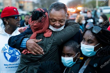 The Rev. Jesse Jackson greets demonstrators during a protest over the fatal shooting of Daunte Wright by a police officer during a traffic stop, outside the Brooklyn Center Police Department, in Brooklyn Center, Minn