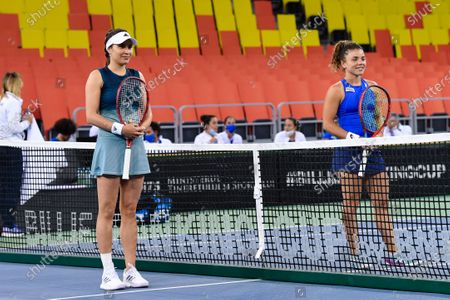 Elena Gabriela Ruse (left) and Jasmine Paolini (right) at the beginning of the match 3 during the Billie Jean King cup in Cluj-Napoca, 17 April 2021