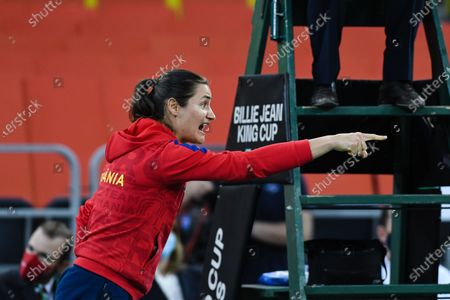 Stock Image of Monica Niculescu, captain of team Romania, encouraging his team-mates during the match against Italy in the Billie Jean King cup in Cluj-Napoca, 17 April 2021