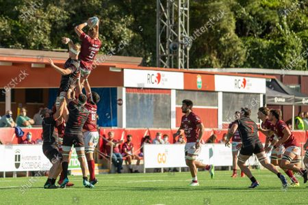 Adrian Hall (red with ball) during Alcobendas Rugby victory over Ampo Ordizia RE (21 - 14) in Liga de División de Honor regular season game (day 15) celebrated in Alcobendas (Spain) at Las Terrazas. April 17th 2021.