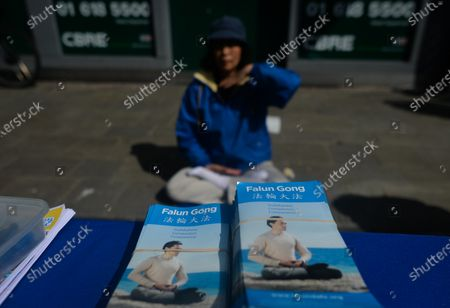 Falun Gong practitioner attend a protest on Grafton Street in Dublin city center, during the COVID-19 lockdown. Falun Gong is a spiritual discipline which spread in China during the 90's. Its practice was progressively opposed by Chinese government. Right human associations allege abuses, tortures, illegal imprisonments, forced labors and murder of Falun Gong followers and organ harvesting to supply transplant industry. On Saturday, 17 April 2021, in Dublin, Ireland.