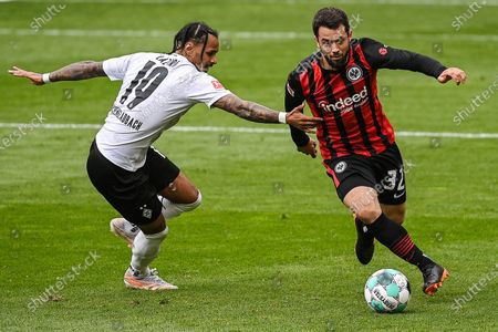 (210418) - MOENCHENGLADBACH, April 18, 2021 (Xinhua) - Amin Younes (R) of Frankfurt breaks through the defense from Valentino Lazaro of Moenchengladbach during a German Bundesliga match between Borussia Moenchengladbach and Eintracht Frankfurt in Moenchengladbach, Germany, April 17, 2021. (Photo by Ulrich Hufnagel/Xinhua) FOR EDITORIAL USE ONLY. - Ulrich Hufnagel -