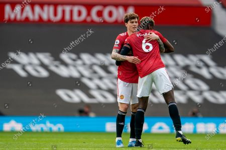 Victor Lindelof and Paul Pogba of Manchester United embrace at the end of the match