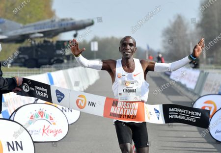 Stock Image of Kenyan Eliud Kipchoge celebrates winning the NN Mission Marathon at Twente Airport in Enschede, the Netherlands, 18 April 2021. The marathon was moved from Hamburg to Twente due to the COVID-19 pandemic restriction measures.