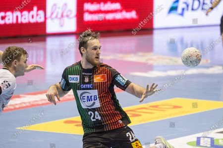 Stock Image of Christian O'Sullivan (right) of SC Magdeburg control the ball during the LIQUI MOLY Handball-Bundesliga match between SC Magdeburg and MT Melsungen at GETEC-Arena on April 18, 2021 in Magdeburg, Germany.