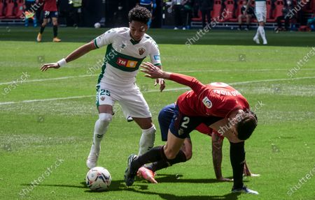 "Ignacio ""Nacho"" Vidal Miralles of C.A. Osasuna and Johan Mojica of Elche CF  fight for the ball  during the spanish league, LaLiga, football match played between CA Osasuna v Elche CF at El Sadar Stadium on april 18, 2021 in Pamplona, Navarra, Spain."