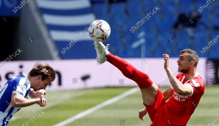 Real Sociedad's midfielder Nacho Monreal (L) fights for the ball with Sevilla's midfielder Joan Jordan (R) during their LaLiga soccer match played at Reale Arena stadium in San Sebastian, Basque Country, Spain on 18 April 2021.