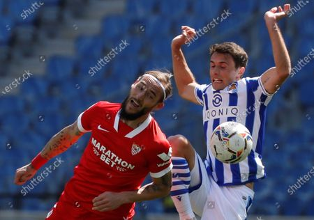 Real Sociedad's midfielder Ander Guevara (R) fights for the ball with Sevilla's midfielder Nemanja Gudelj (L) during their LaLiga soccer match played at Reale Arena stadium in San Sebastian, Basque Country, Spain on 18 April 2021.