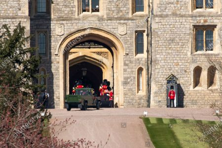 After seven days of mourning Prince Philip will be laid to rest today (Sat) in a small private funeral at St George's Chapel, Windsor, Berks..Pictures shows Land Rover hurst arriving at Windsor Castle.