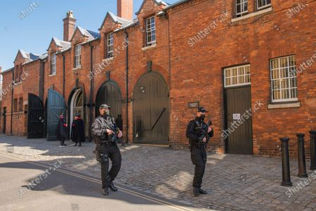 After seven days of mourning Prince Philip will be laid to rest today (Sat) in a small private funeral at St George's Chapel, Windsor, Berks..Picture shows armed police around Windsor Castle.
