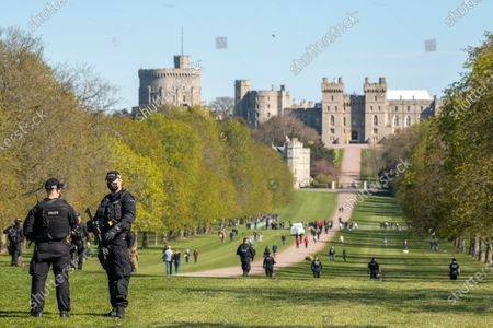 After seven days of mourning Prince Philip will be laid to rest today (Sat) in a small private funeral at St George's Chapel, Windsor, Berks..Picture shows armed police at the Long Walk.
