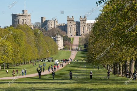 Stock Photo of After seven days of mourning Prince Philip will be laid to rest today (Sat) in a small private funeral at St George's Chapel, Windsor, Berks..Picture shows armed police at the Long Walk.