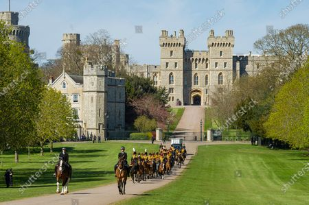 After seven days of mourning Prince Philip will be laid to rest today (Sat) in a small private funeral at St George's Chapel, Windsor, Berks..Pictures shows King's Troop, Royal Horse Artillery leaving Windsor Castle.