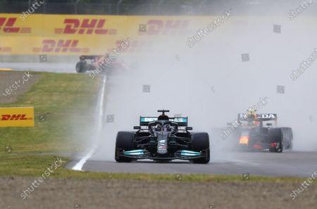 Sir Lewis Hamilton, Mercedes W12, leads Sergio Perez, Red Bull Racing RB16B during the 2021 Formula One Emilia Romagna Grand Prix