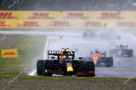 Sergio Perez, Red Bull Racing RB16B, leads Daniel Ricciardo, McLaren MCL35M during the 2021 Formula One Emilia Romagna Grand Prix