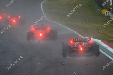 Charles Leclerc, Ferrari SF21, leads Sergio Perez, Red Bull Racing RB16B during the 2021 Formula One Emilia Romagna Grand Prix
