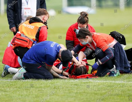 Hannah Goodburn of St Helens lies on the floor with an injury