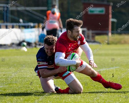 Elliot Daly of Saracens is tackled