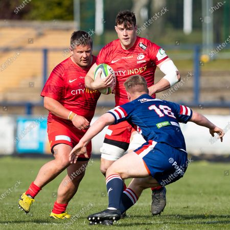 Callum Hunter-Hill of Saracens is tackled by Joe Jones of Doncaster Knights