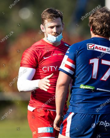 Elliot Daly of Saracens and Josh Pieterse of Doncaster Knights shake hands after the final whistle