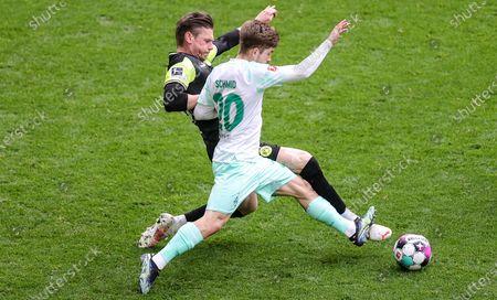 Dortmund's Lukasz Piszczek (L) in action against Bremen's Romano Schmid (R) during the German Bundesliga soccer match between Borussia Dortmund and Werder Bremen at Signal Iduna Park in Dortmund, Germany, 18 April 2021.
