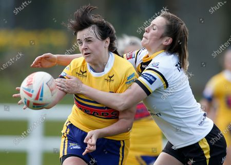 Stock Image of Leeds Rhinos' Hanna Butcher and York City Knights' Georgia Taylor in action