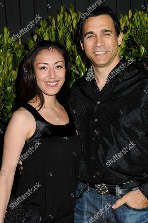 Adrian Paul  and Alexandra Tonelli