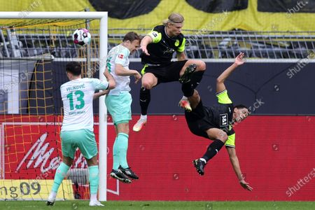 Bremen players Milos Veljkovic (L) and Christian Gross (2-L) in action against Dortmund players Erling Haaland (2-R) and Jude Bellingham (R) during the German Bundesliga soccer match between Borussia Dortmund and Werder Bremen in Dortmund, Germany, 18 April 2021.