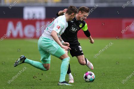 Marco Friedl (L) of Bremen in action against Lukasz Piszczek (R) of Dortmund during the German Bundesliga soccer match between Borussia Dortmund and Werder Bremen in Dortmund, Germany, 18 April 2021.