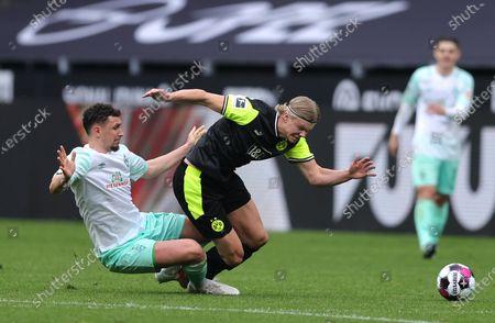 Bremen's Milos Veljkovic (L) in action against Dortmund's Erling Haaland (C) during the German Bundesliga soccer match between Borussia Dortmund and Werder Bremen in Dortmund, Germany, 18 April 2021.