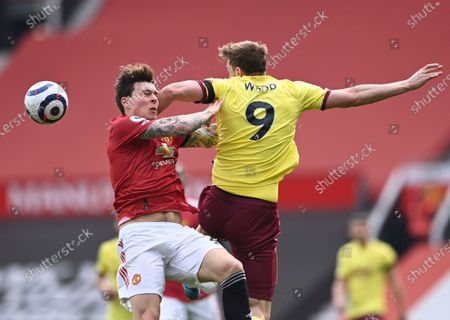 Manchester United's Victor Lindelof, left, and Burnley's Chris Wood challenge for the ball during the English Premier League soccer match between Manchester United and Burnley at the Old Trafford stadium in Manchester, England