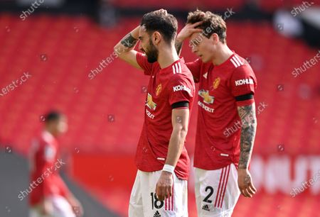 Manchester United players Bruno Fernandes (L) and Victor Lindelof (R) react during the English Premier League soccer match between Manchester United and Burnley FC in Manchester, Britain, 18 April 2021.