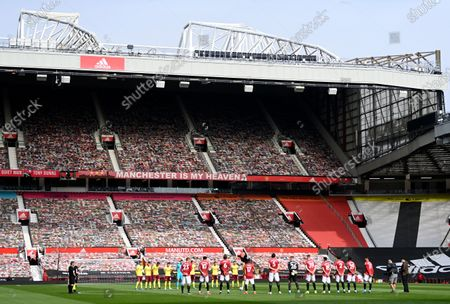 Players of Manchester United (front) and Burnley (back) observe a minute of silence in memory of late Prince Philip, Duke of Edinburgh and husband of Queen Elizabeth II, prior to the English Premier League soccer match between Manchester United and Burnley FC at Old Trafford in Manchester, Britain, 18 April 2021.