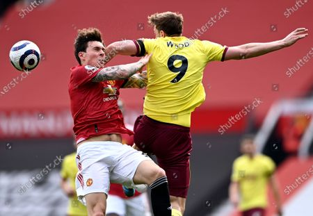 Victor Lindelof (L) of Manchester United in action against Chris Wood (R) of Burnley during the English Premier League soccer match between Manchester United and Burnley FC in Manchester, Britain, 18 April 2021.